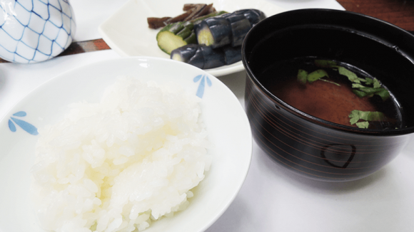 White rice, pickled vegetables, and miso soup.