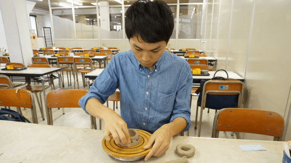 Working the clay with inexperienced hands.