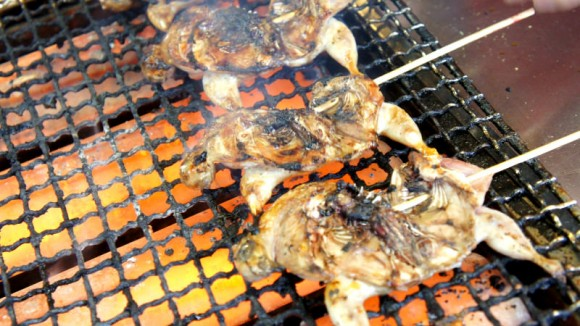 Whole skewered quail