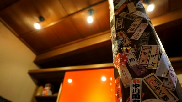 Look at the wooden post with Maiko and Geiko name stickers