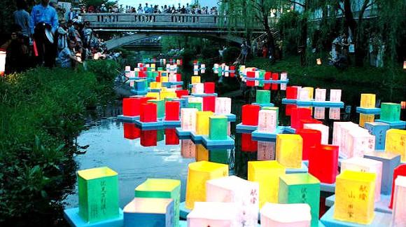 Sending lanterns into the river